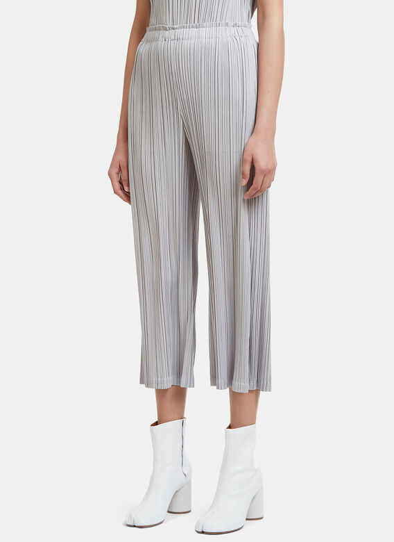 7d4a07f0e3a1 Pleats Please Issey Miyake Cropped Pleated Pants in Grey