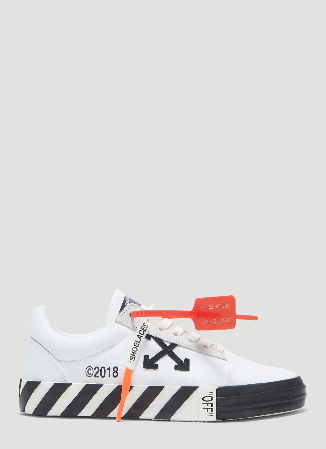 Off White Vulcanized Low Top Sneakers in White | LN CC