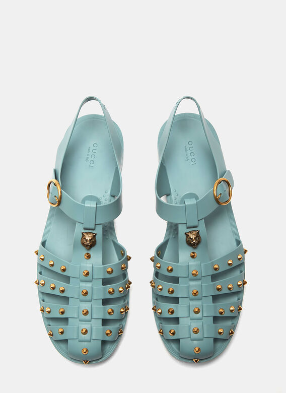 6321bd1d65cd1 Gucci Tiger Head Studded Rubber Buckle Sandals